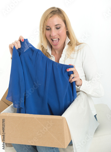 Happy woman with online clothes purchase