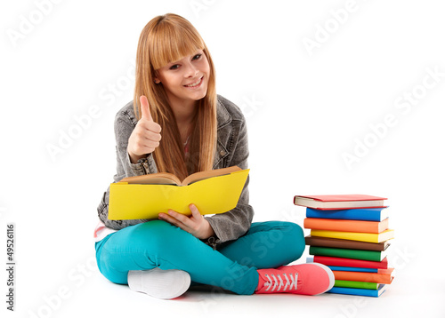 Young girl with books. Isolated on white background