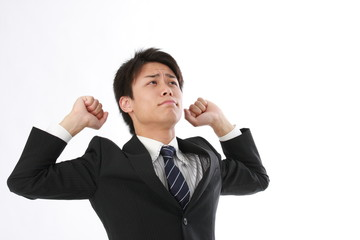 背伸びをするビジネスマン