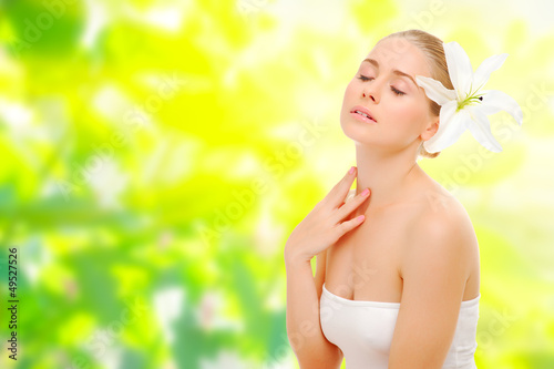 Young healthy girl on spring background