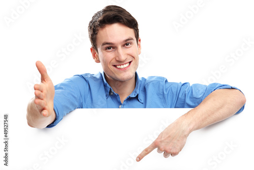Man pointing at blank copy space
