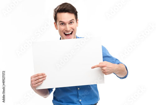 Young man pointing towards blank sign