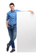 Young man by blank whiteboard