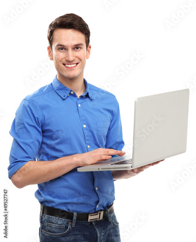 Portrait of young man holding laptop