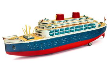 Antique toy cruise ship isolated on white