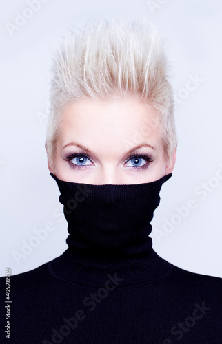 blonde woman with short hair wearing black turtleneck