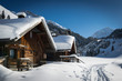 wooden houses on austrian mountains at winter with a lot of snow