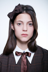 young school girl wearing old vintage style formal clothes