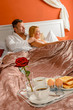 Romantic breakfast hotel room service young couple