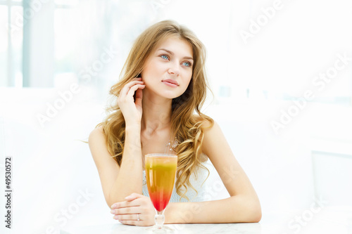 Young woman with a glass of drink