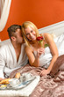 Romantic couple cuddling bed motel celebrating anniversary