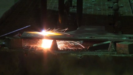 machine slowly cut metal in industrial plants