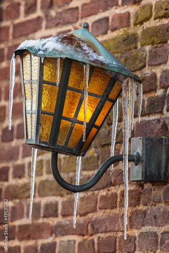 Antique lantern covered with icicles