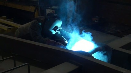 male welder working at the factory