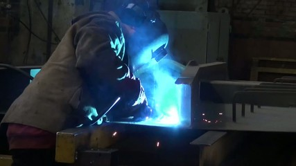 man working with metal at the plant
