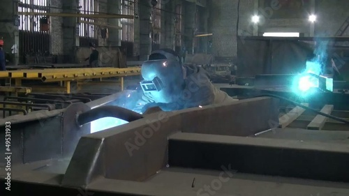 people work in the factory flash from welding