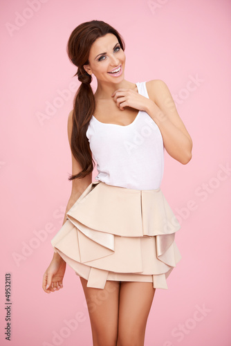 Cute brunette on pink