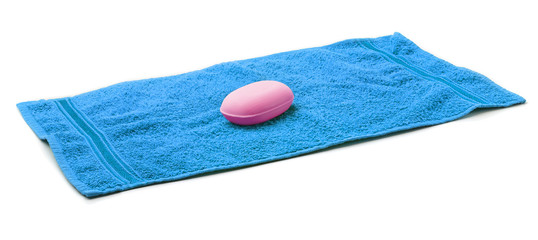 Blue Towel with bar of pink Soap.