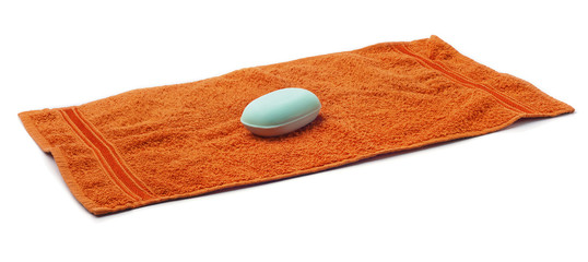 Orange Towel with bar of blue Soap.