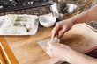 Creating homemade Chinese Spring Rolls in kitchen