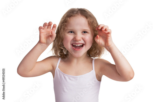 Little cheerful girl playfully scare someone