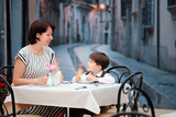Mother and son having lunch together poster
