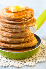 Whole wheat oatmeal pancakes with butter and syrup