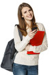 Woman student with backpack sending sms on cell phone