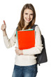 Woman with backpack holding notebooks showing thumb up