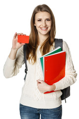 Woman student holding textbooks showing blank credit card