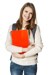 Happy woman wearing backpack holding textbooks