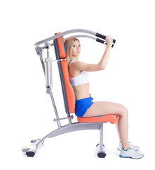 Young woman sitting on exerciser