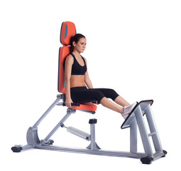 Young woman on hydraulic exerciser isolated