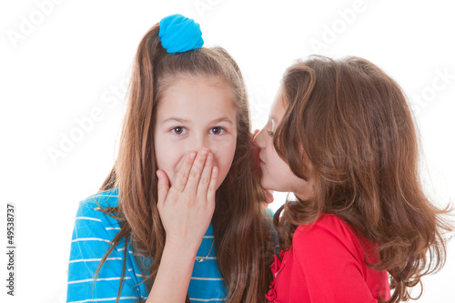 kids whispering gossip secrets or scandal