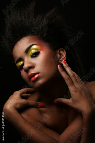 Beautiful black woman with glossy makeup