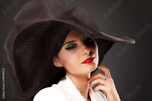 Retro style woman with bright makeup