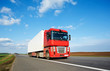 Red lorry trailer over blue sky