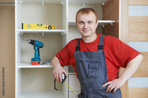Portrait of wardrobe installation joiner