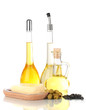 Different types of oil with sunflower seeds and olives isolated