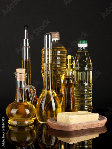 Different types of oil on dark background