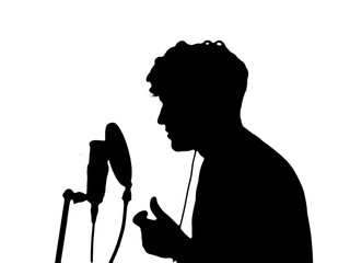 man in headphones singing into a microphone on a white backgroun