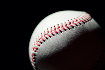 Studio shot of a baseball ball, black background