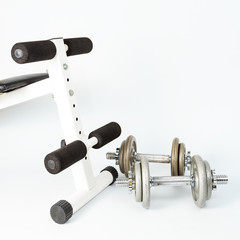 Silver metal dumbbells, one on another isolated on white
