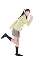Girl in green sweater and skort in running position, isolated