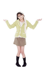 Girl in green sweater and glasses gesturing 'I do not know'.