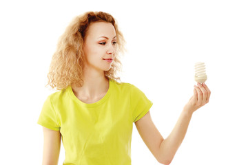 A woman with an energy-saving bulb in her hands