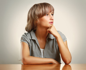 Tired young woman sitting at desk