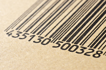 barcode printed on a cardboard box, making macro
