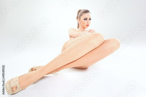 beautiful woman with long sexy legs wearing skin color stockings