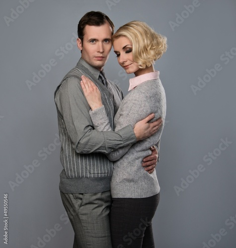Elegant couple isolated on grey background